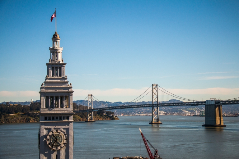 bay-clock-tower-sky-bridge-flag-san-francisco