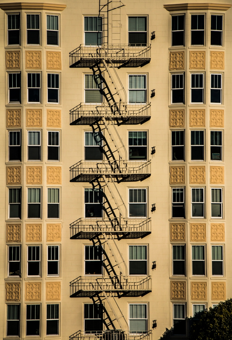 yellow-building-windows-stairs-apartments-san-francisco
